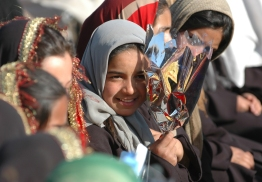 A Provisional Reconstruction Team lead by Americans and Italians opened an all-girls school in Herat, Afghanistan, in 2005. Many of the future students were in attendance at this ceremony where the corner stone was laid, a cow was sacrificed, and a feast was shared. ~ Adriane Shulte