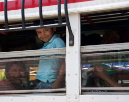 After a day of surfing outside of San Juan del Sur, Nicaragua, in 2009, I passed a stretch of road full of busses headed to all points in country. I snagged this image of a fellow traveler. ~ Adriane Shulte