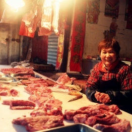 A vendor in Suzhou answers my tentative request for a photo with a welcoming smile. ~ Vicki Valosik
